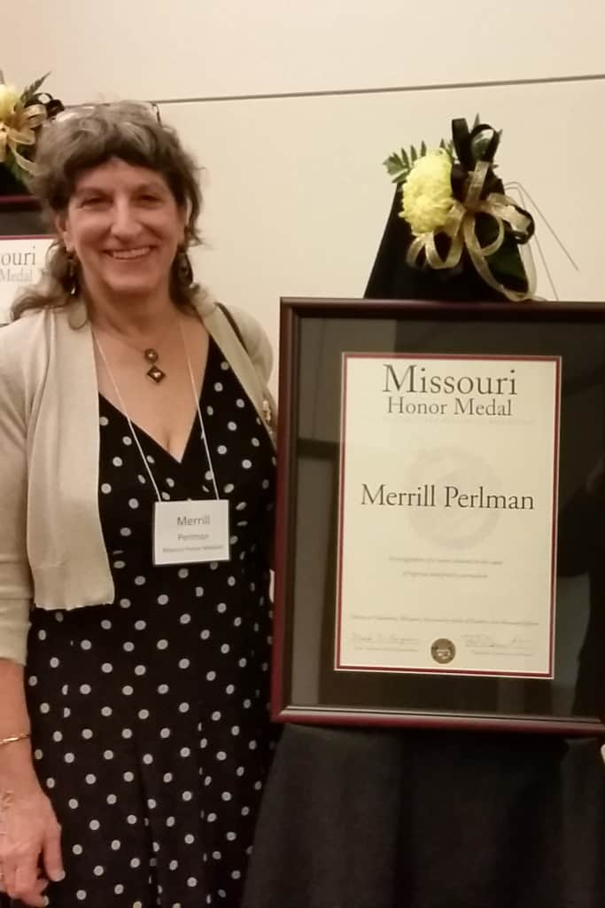 Merrill Perlman next to presentation award of Mussouri Honor Medal